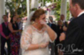 Patti wipes away a tear during her August 2018 wedding ceremony at the Walter J. Dempsey Memorial Bandstand in Norwood, Massachusetts.