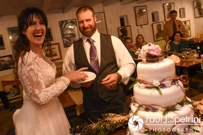 Samantha and Dale cut the cake during their October 2017 wedding reception at the Golden Lamb Buttery in Brooklyn, Connecticut.