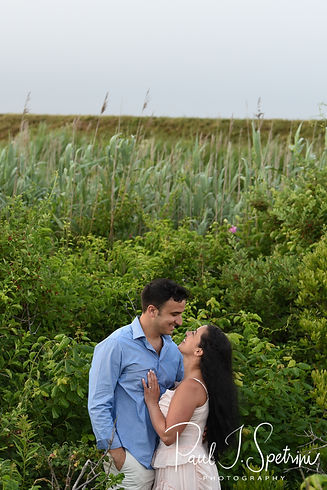 Jocelyn & Ricky pose for a photo during their July 2018 engagement session at a location across the street from Second Beach in Middletown, Rhode Island.