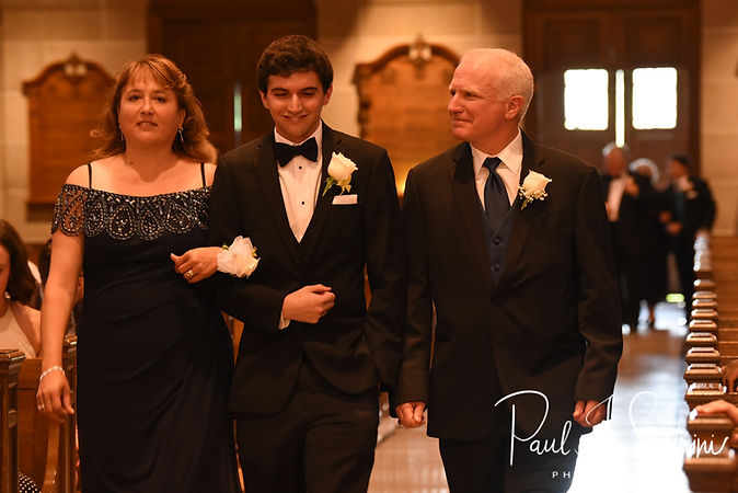 Brian walks down the aisle with his parents during his June 2018 wedding ceremony at the College of the Holy Cross in Worcester, Massachusetts.