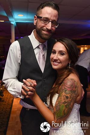 Stacey dances with her brother during her September 2017 wedding reception in Warren, Rhode Island.