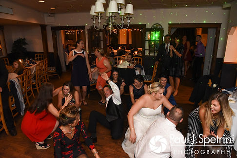 Jennifer dances with guests during her September 2017 wedding reception at Oceanside at the Pier in Narragansett, Rhode Island.