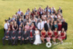 Latasha and Justin pose for a photo with all of their guests following their May 2016 wedding at Country Gardens in Rehoboth, Massachusetts.