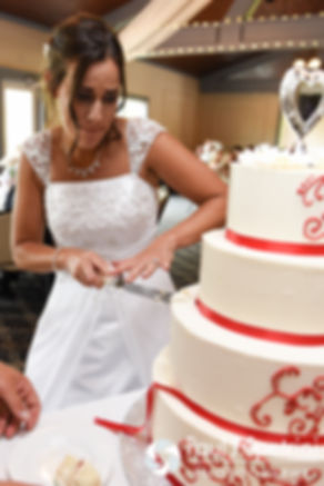 Heather cuts the cake during her July 2016 wedding reception at Crystal Lake Golf Club in Burrillville, Rhode Island.