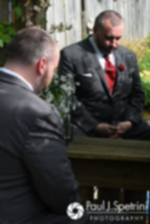 Justin waits for Latasha during their first look prior to their May 2016 wedding at Country Gardens in Rehoboth, Massachusetts.