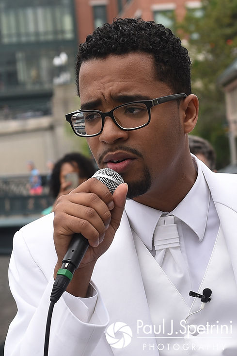 Luis sings to Lucelene during his June 2017 wedding ceremony at Waterplace Park in Providence, Rhode Island.