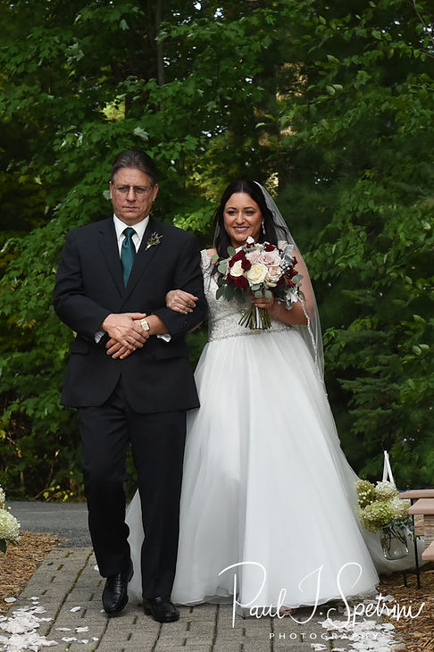 Lizzy walks down the aisle during her September 2018 wedding ceremony at Crystal Lake Golf Club in Mapleville, Rhode Island.