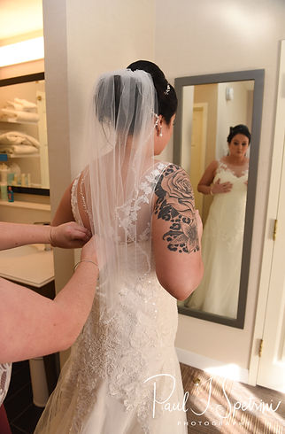 Justine has her dress zipped prior to her October 2018 wedding ceremony at Twelve Acres in Smithfield, Rhode Island.