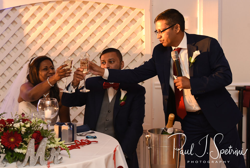 Jimmy and Saken toast with the best man during their July 2018 wedding reception at Lake Pearl in Wrentham, Massachusetts.