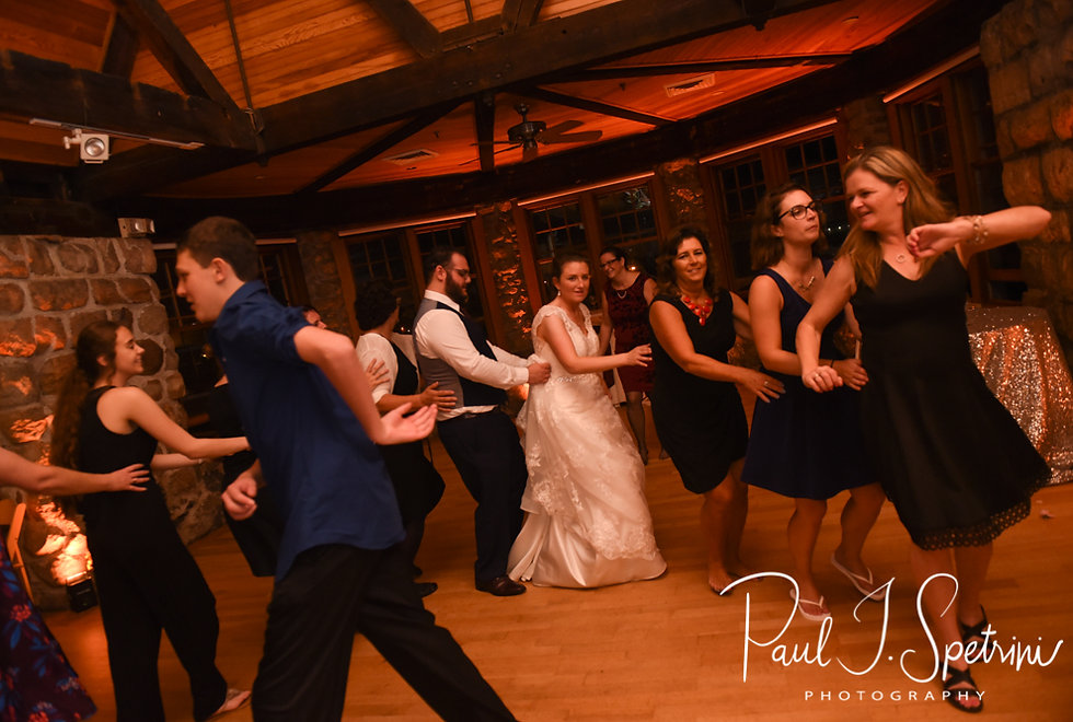 Rob and Allie dance in a line during their October 2018 wedding reception at The Towers in Narragansett, Rhode Island.