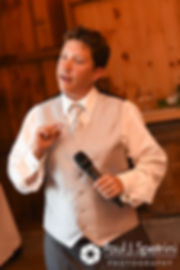 A member of the wedding party gives a speech during Kevin and Jen's September 2017 wedding reception at Allen Hill Farm in Brooklyn, Connecticut.