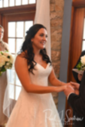 Nicole smiles during her September 2018 wedding ceremony at The Towers in Narragansett, Rhode Island.