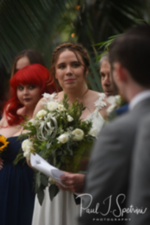 Ali looks on during her May 2018 wedding ceremony at the Roger Williams Park Botanical Center in Providence, Rhode Island.