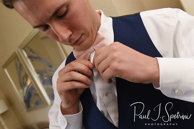 Michael adjusts his shirt at the hotel prior to his August 2018 wedding ceremony at the Squantum Association in Riverside, Rhode Island.