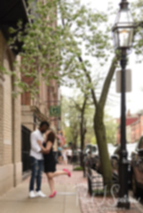 Courtnie and Richie pose for a photo on the streets of Boston, Massachusetts during their May 2018 engagement session.