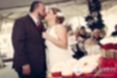 Latasha and Justin share a kiss after cutting their wedding cake during their May 2016 wedding at Country Gardens in Rehoboth, Massachusetts.