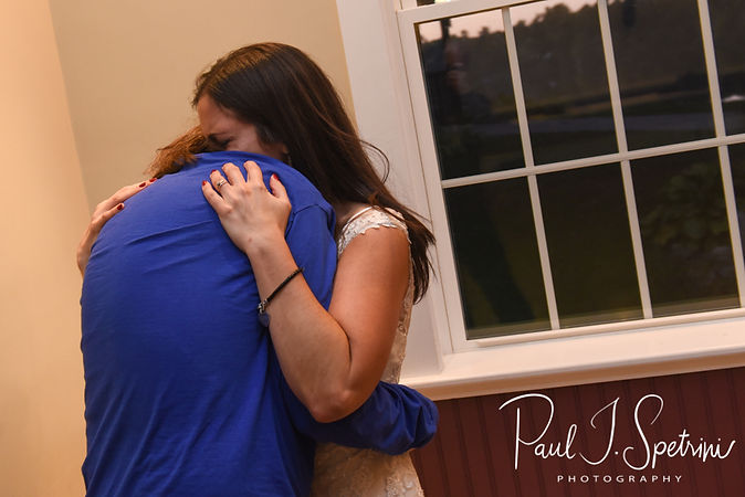 Amanda and Josh hug during their October 2018 wedding reception at Loon Pond Lodge in Lakeville, Massachusetts.