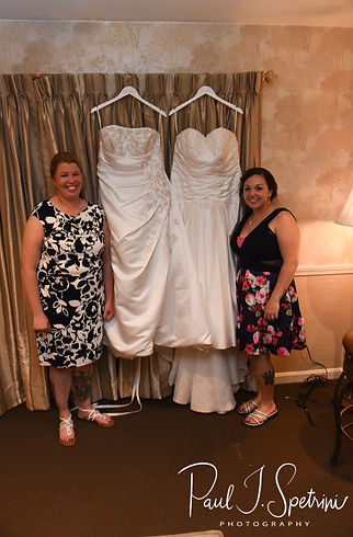 Laura and Marijke pose for a photo during their June 2018 wedding reception at Independence Harbor in Assonet, Massachusetts.