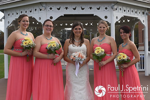 Marissa and her bridesmaids pose for a photo prior to her September 2016 wedding ceremony at Beavertail Lighthouse in Jamestown, Rhode Island.