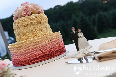 A look at the wedding cake featured at Justin and Lauryn's July 2016 wedding reception at the Overlook at Geer Tree Farm in Griswold, Connecticut.