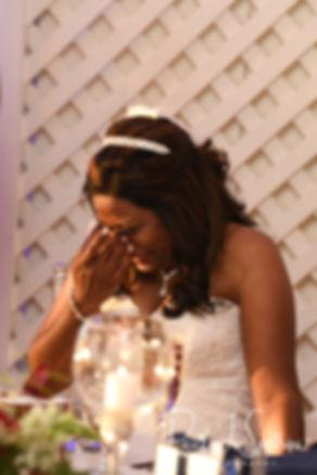 Saken gets emotional during her July 2018 wedding reception at Lake Pearl in Wrentham, Massachusetts.