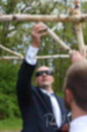 Mike builds an arch prior to his May 2018 wedding ceremony at Bittersweet Farm in Westport, Massachusetts.