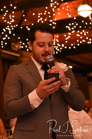 The best man gives a toast during Nicole & Dan's September 2018 wedding reception at The Towers in Narragansett, Rhode Island.
