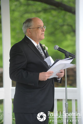 Melissa's uncle officiates her and Jordan's May 2017 wedding ceremony at Independence Harbor in Assonet, Massachusetts.
