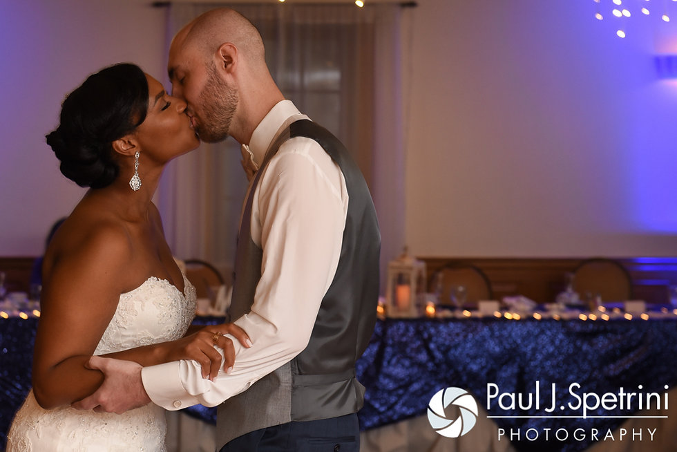 Jennifer and Mark kiss during their September 2016 wedding reception at the RI Shriners and Imperial Room at Rhodes Place in Providence, Rhode Island.