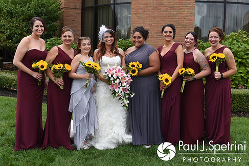 Nicky poses for a formal photo with her bridesmaids following her September 2017 wedding ceremony at the Crowne Plaza Hotel in Warwick, Rhode Island.