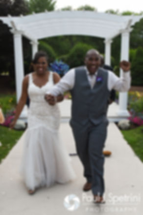 Kemi and Warren celebrate following their August 2016 wedding reception at the Villa at Riddler Country Club in East Bridgewater, Massachusetts.
