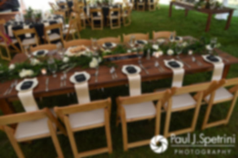 A look at the table settings prior to Molly and Tim's June 2017 wedding reception at Farmhouse-By-The-Sea in Matunuck, Rhode Island.