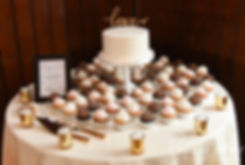 A look at the cake table, shown on display during Michael & Miranda's August 2018 wedding reception at the Squantum Association in Riverside, Rhode Island.