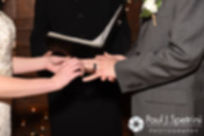 Ellen puts a ring on Jeremy during their May 2016 wedding at Bittersweet Farm in Westport, Massachusetts.