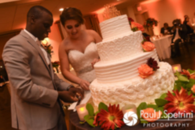 Kevin and Kristina cut their wedding cake during their October 2017 wedding reception at the Villa Ridder Country Club in East Bridgewater, Massachusetts.