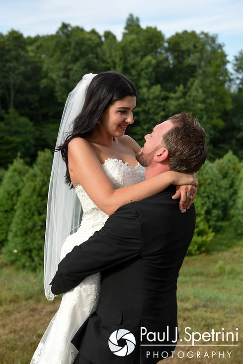 Lauryn and Justin embrace during a formal photo at their July 2016 wedding reception at the Overlook at Geer Tree Farm in Griswold, Connecticut.