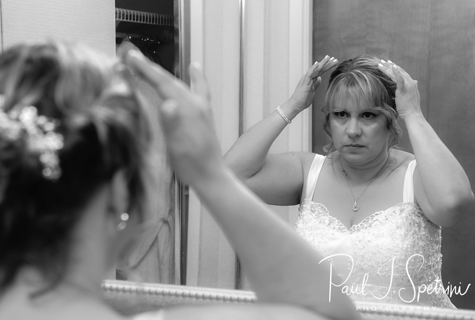Robin adjusts her hair prior to her August 2018 wedding ceremony at Twelve Acres in Smithfield, Rhode Island.