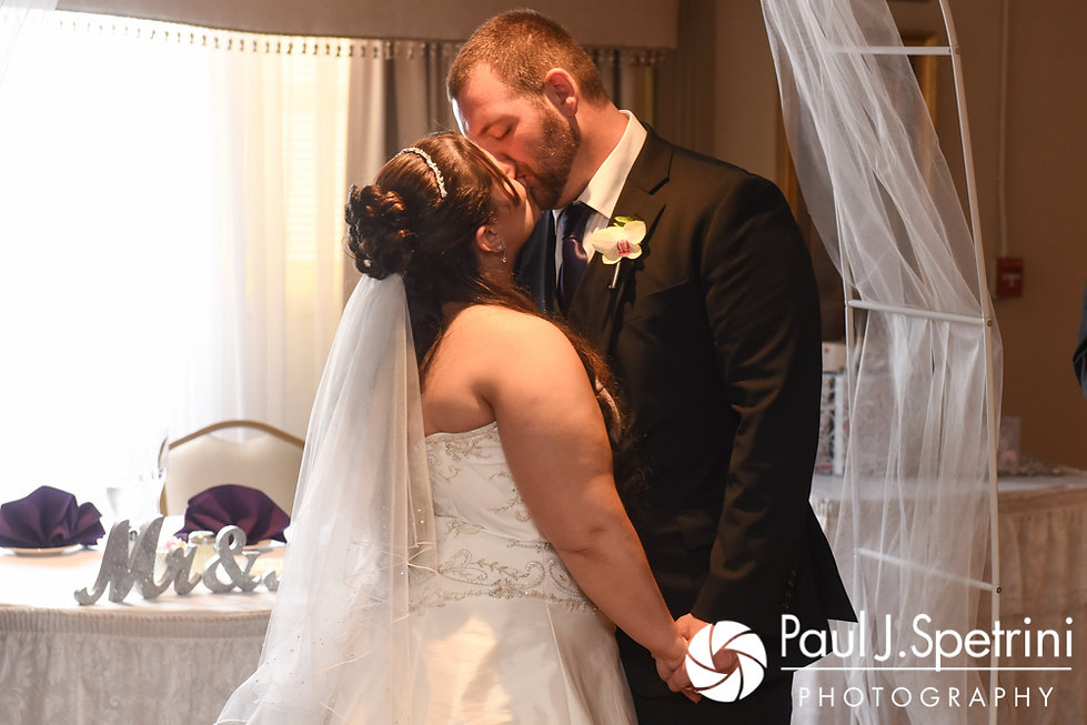 Clarissa and Jeffrey share their first kiss during their June 2017 wedding ceremony at Twelve Acres in Smithfield, Rhode Island.