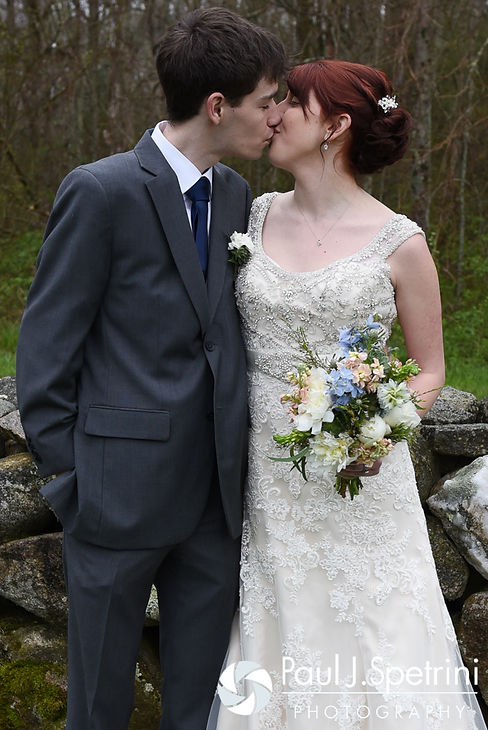 Ellen and Jeremy kiss during a formal photo following their May 2016 wedding at Bittersweet Farm in Westport, Massachusetts.