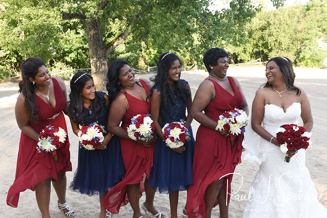 Saken and her bridesmaids pose for a photo following her July 2018 wedding ceremony at Lake Pearl in Wrentham, Massachusetts.