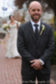 Mike waits to turn around for a first look at his bride Emma prior to their November 2015 wedding at the Publick House in Sturbridge, Massachusetts.