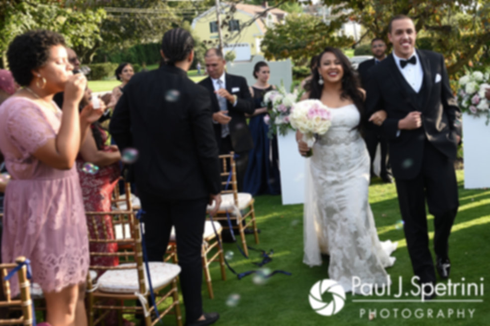 Arten and Stephany walk down the aisle following their September 2017 wedding ceremony at Wannamoisett Country Club in Rumford, Rhode Island.