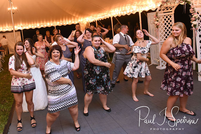 Guests dance during Karolyn & Ethan's August 2018 wedding reception at a private residence in Sterling, Connecticut.