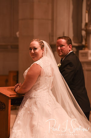 Courtney and Patrick smile for a photo during their September2018 wedding ceremony at St. Paul Church in Cranston, Rhode Island.