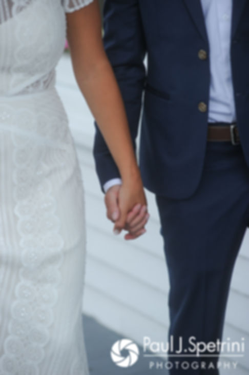 Jennifer and Bruce hold hands during a first look prior to their August 2017 wedding ceremony at The Inn at Mystic in Mystic, Connecticut.