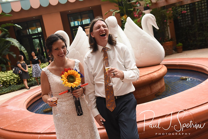 Amanda and Josh laugh following their October 2018 wedding ceremony at the Walt Disney World Swan & Dolphin Resort in Lake Buena Vista, Florida.