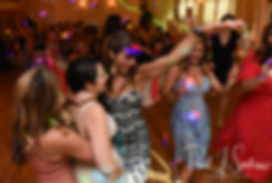 Stephanie dances with guests during her June 2018 wedding reception at Foster Country Club in Foster, Rhode Island.