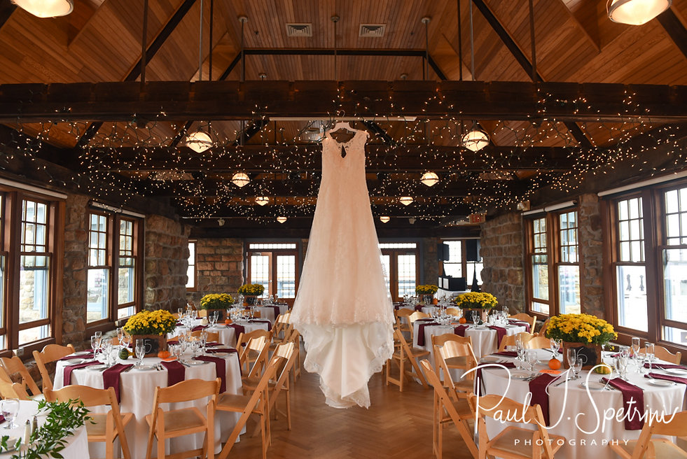 Allie's dress hangs prior to her October 2018 wedding reception at The Towers in Narragansett, Rhode Island.