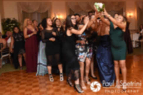 Guests battle for the bouquet during Stephany and Arten's September 2017 wedding reception at Wannamoisett Country Club in Rumford, Rhode Island.