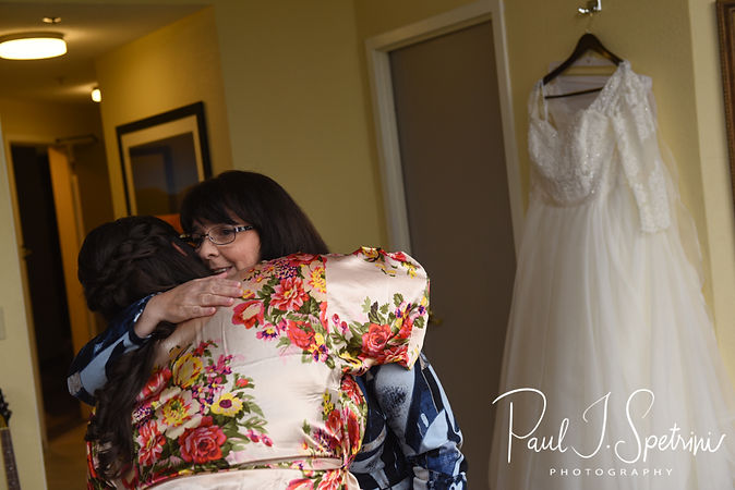 Katie hugs her mother during bridal prep prior to her October 2018 wedding ceremony at The Villa at Ridder Country Club in East Bridgewater, Massachusetts.